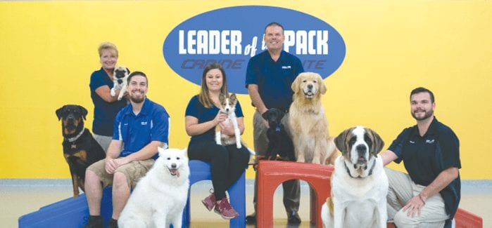 Reader's Choice family photo of Leader of the Pack Canine Institute best dog training & grooming